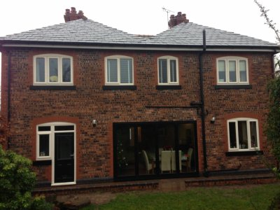 Big home extension with patio doors, rear of house in Warrington